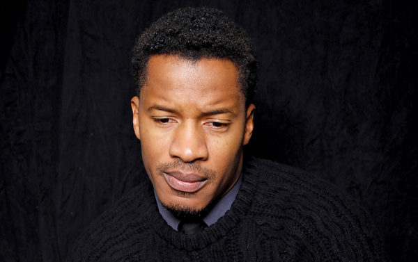 """Director, writer, and actor Nate Parker poses for a portrait to promote the film, """"The Birth of a Nation"""", at the Toyota Mirai Music Lodge during the Sundance Film Festival on Monday, Jan. 25, 2016 in Park City, Utah. (Photo by Matt Sayles/Invision/AP)"""