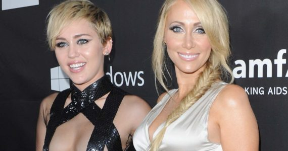 HOLLYWOOD, CA - OCTOBER 29: Singer Miley Cyrus and Tish Cyrus arrive at the 2014 amfAR LA Inspiration Gala at Milk Studios on October 29, 2014 in Hollywood, California. (Photo by Jon Kopaloff/FilmMagic)