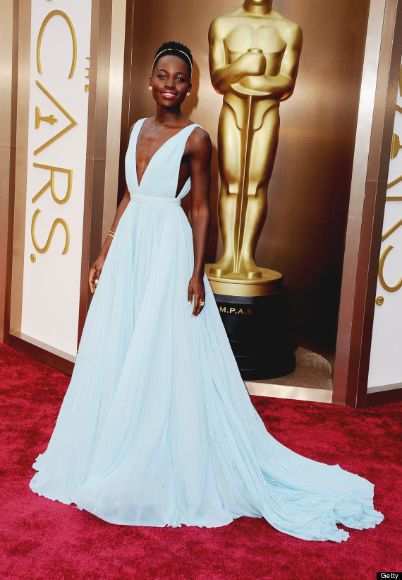 Lupita Nyong'o attends in 2014 wearing Prada and Fred Leighton jewelry. Photo by Steve Granitz/WireImage