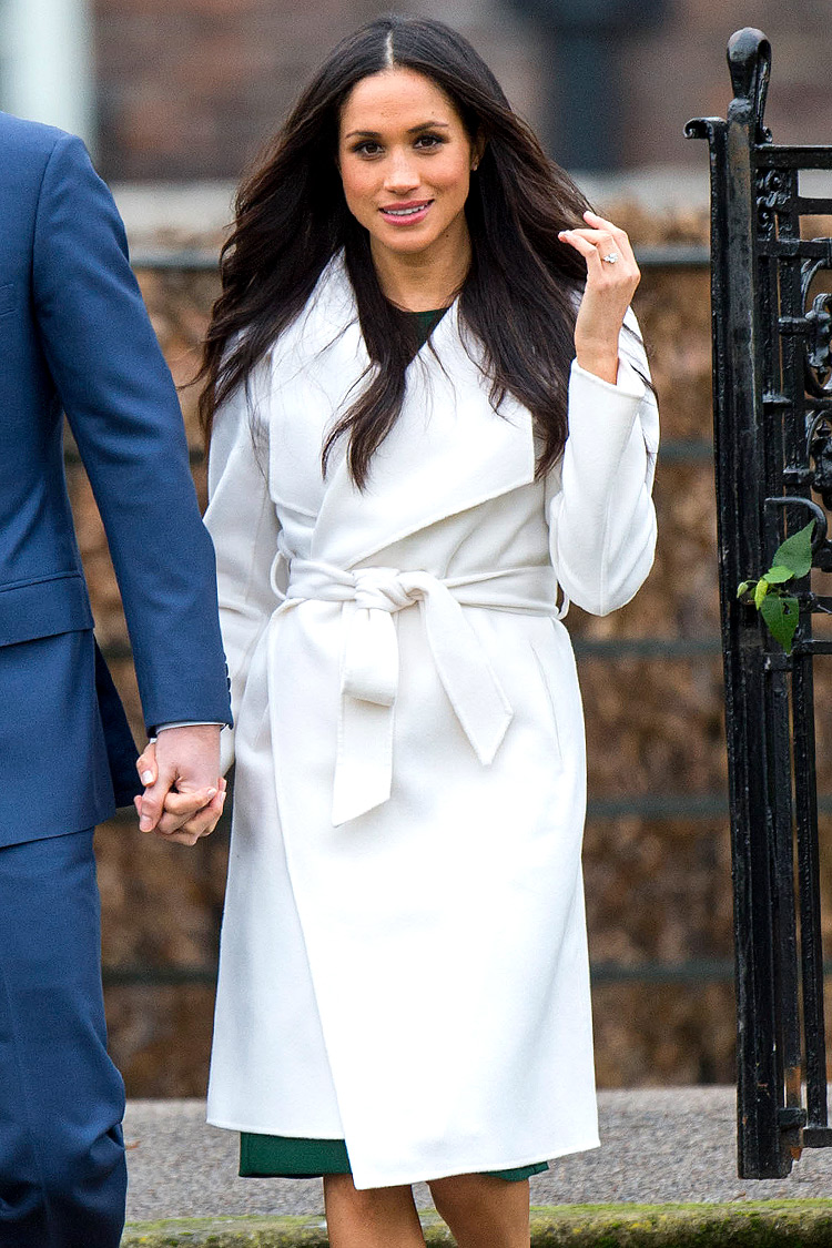 Meghan Markle and Prince Harry arrive at the photocell following the announcement of their engagement. Photo by Mark Cuthbert/UK Press via Getty Images