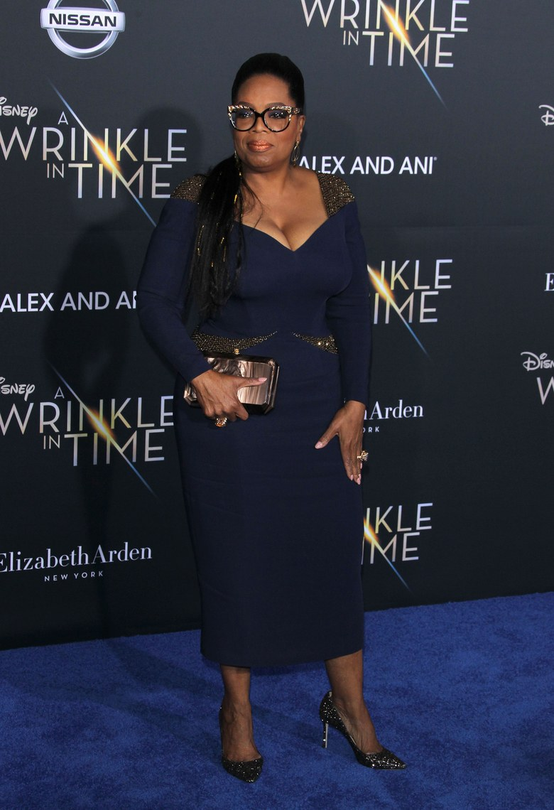 Oprah Winefrey wearing Altelier Versace at the A Wrinkle in Time premiere via Shutterstock
